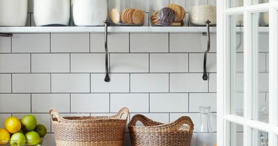 Walk in pantry with shelves and storage jars