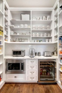 Walk in pantry with drinks cooler microwave and breakfast station