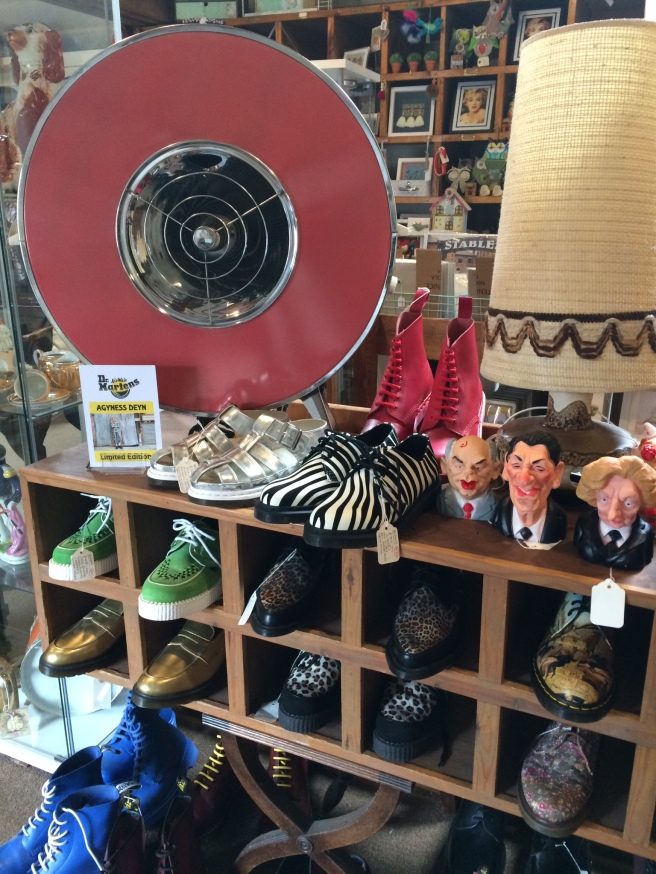 Selection of Doc Martin Boots, vintage heaters and lamp