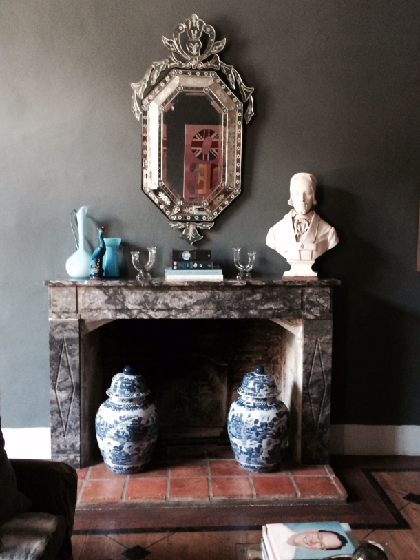 Hearth and fireplace style with Venician mirror bust blue glass and Chinese vases
