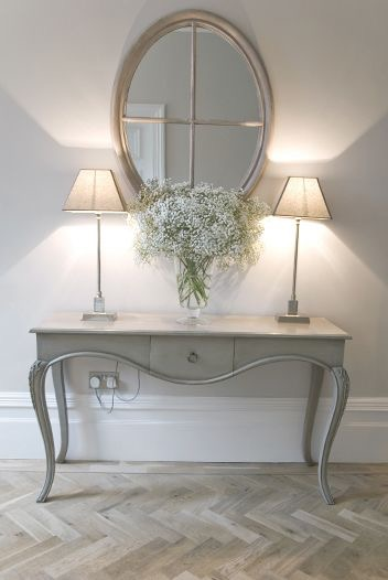 Square shaped lampshades on a console table