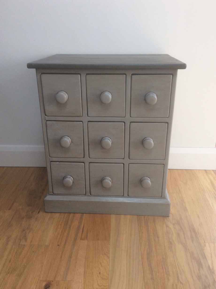 Small multi chest of drawers mid grey dark grey top. Slightly distressed