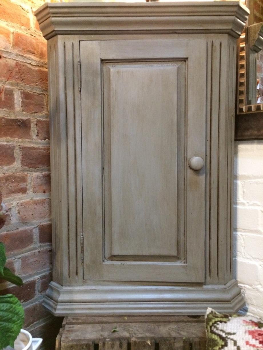Small wall mounted grey distressed corner cupboard