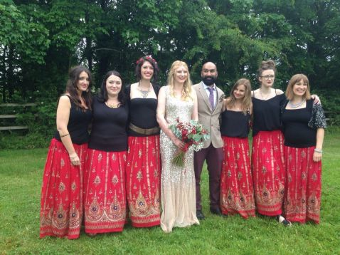 Bride groom and bridesmaids at their rustic fusion wedding