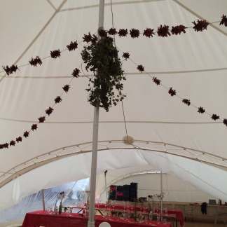 Chilli garlands with a hop rose and chilli centre piece in a marquee
