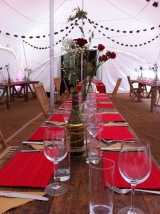 Simple table setting for a rustic fusion wedding in a marquee