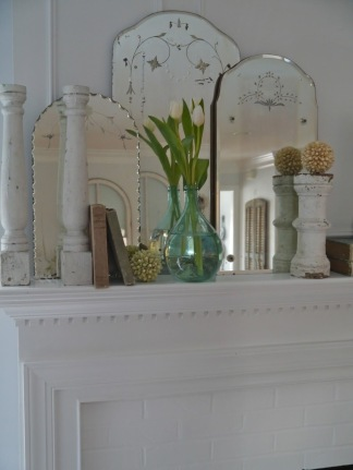 Small Group of mirrors decorate a mantle