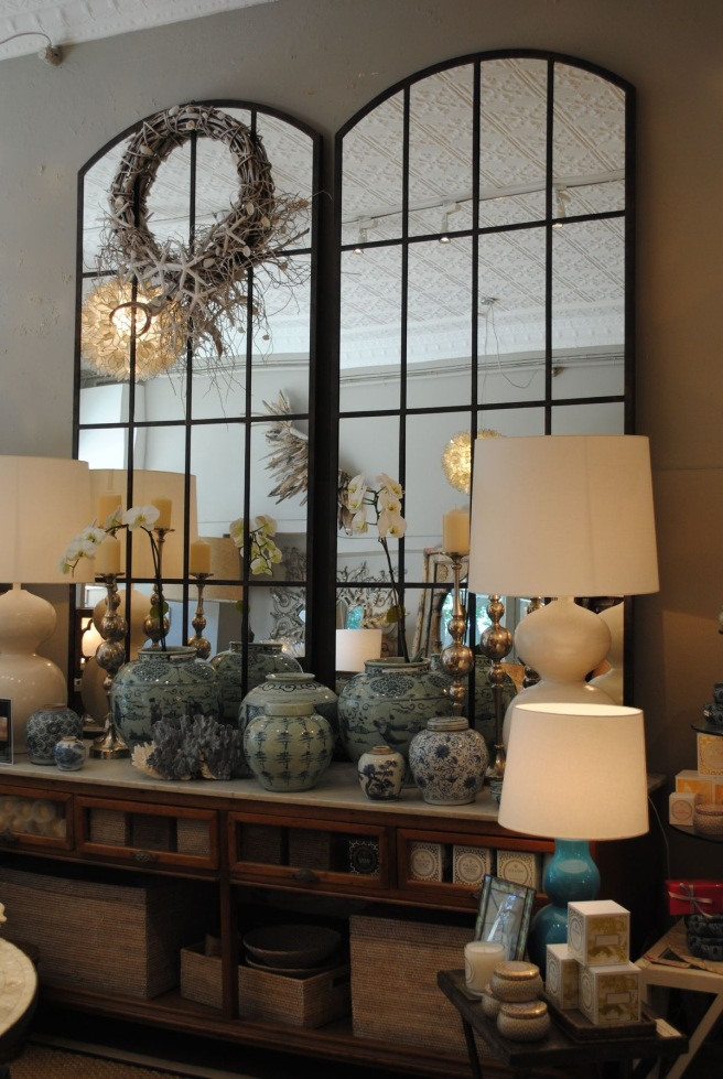 Lamps placed in front of large mirrors creates a vingnette