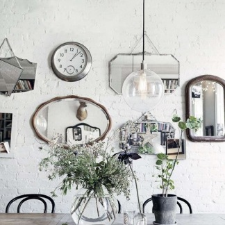 Collection of mirrors Eclectic mixed display of wall mirrors
