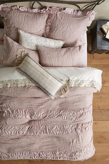 Blush frilly bedding By Anthropologie
