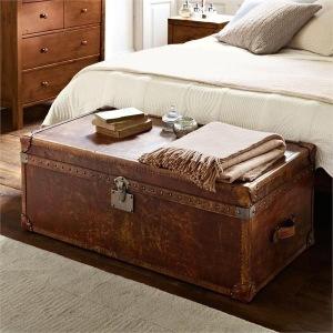 Vintage leather trunk storage in bedroom