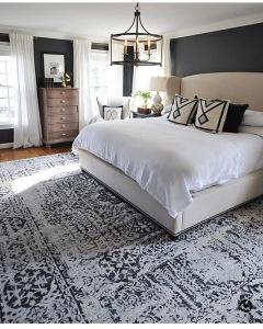 Large patterned rug in master bedroom