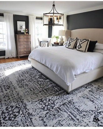 Large patterned rug in master bedroom