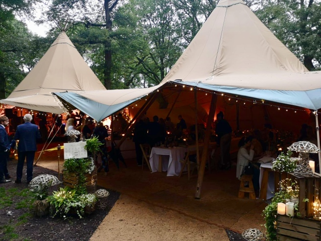 Tipi entrance decorated for a woodland wedding