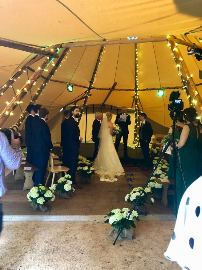 White potted hydrangea aisle in a Tipi wedding
