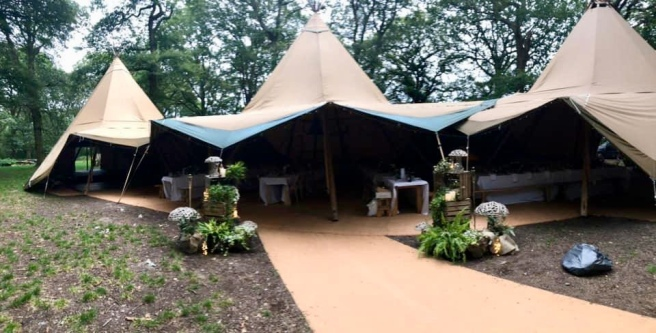 Woodland wedding Tipi entrance being prepared