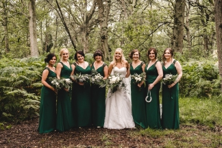 Bride and bridesmaids at a woodland wedding